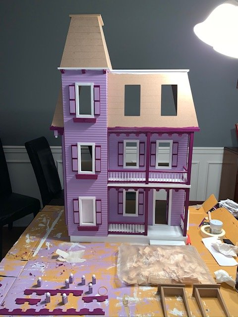 Picture of a dollhouse being built